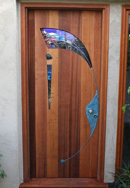 stained glass  wood entry door  james hubbell
