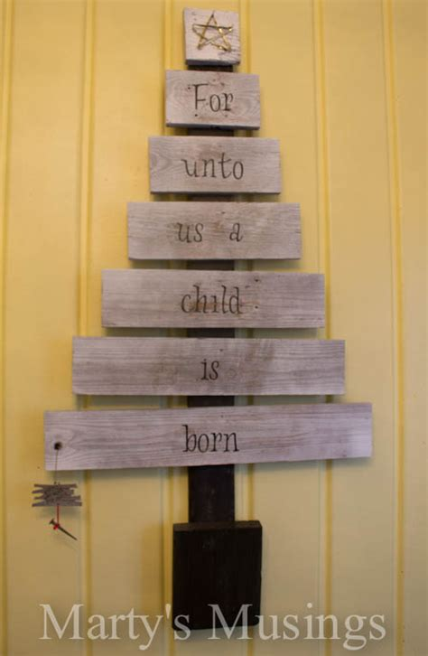 hometalk unique christmas tree  repurposed fence boards