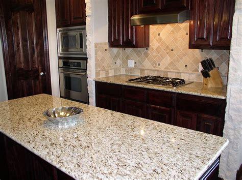 ornamental white granite with white cabinets tile backsplash with giallo ornamental granite countertops