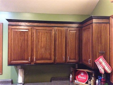 stained  honey oak cabinets darker  added trim   top  bottom