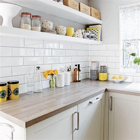 white kitchen  metro tiles  open shelves