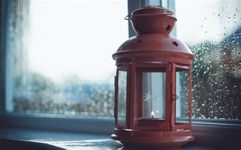 candle jar seashells window rain evening