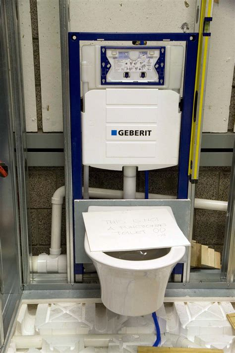 geberit frame  wall hung toilet fixture attached