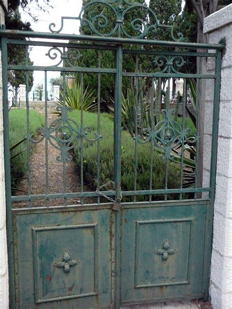decorative gates leading   formal garden  stella maris monastery haifa israel iron