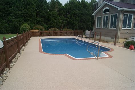 pool design with patio concrete resurfacing between fence