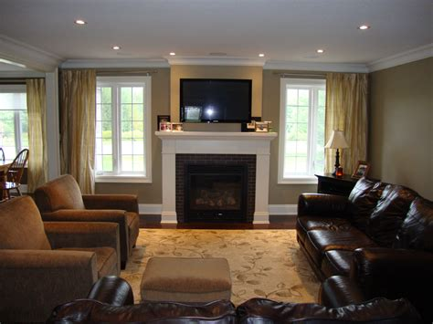 Living Room With Fireplace And Windows by Great Room With Windows Flanking Fireplace Furniture