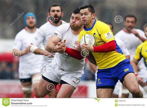 Ambasadorul desemnat al româniei în georgia, răzvan rotundu a prezentat copiile scrisorilor de acreditare vice prim. Romania-Georgia Rugby editorial image. Image of crowd - 31863750