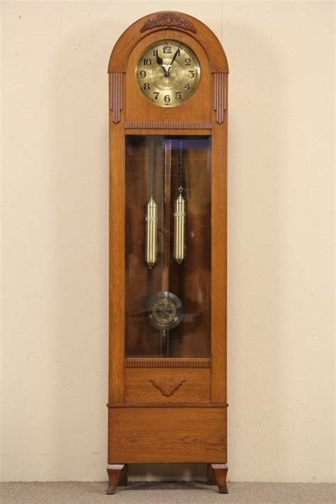 sold oak tall case grandfather clock  antique