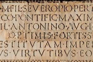 Close up of ancient Roman Latin Inscription in stone ...