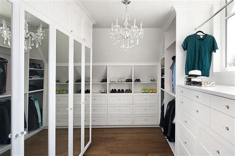 floor to ceiling tension rod closet bedroom built in dresser flanked by wardrobe cabinets