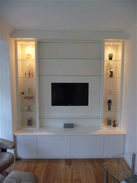 builtin wall unit with inset tv and speakers with av storage below corwell