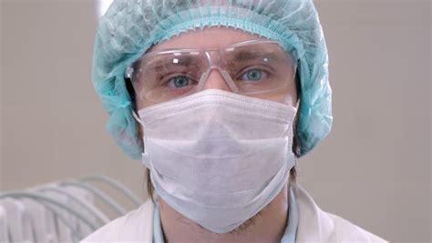 surgical mask doctor hospital surgeon female wear male scrubs wearing bad sad gloves eyes clip 4k concept shutterstock preparing tell