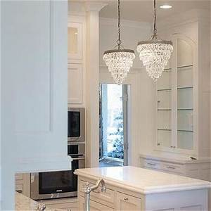 Cabinet over kitchen sink design ideas for Kitchen cabinets lowes with metal wall art with crystals