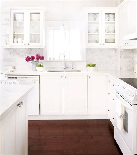 white cabinets countertop what color floor kitchen the white cabinets and carrara marble