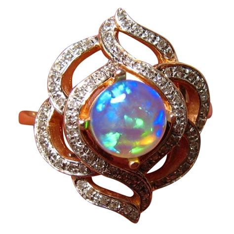 Round Blue Opal Diamond Gold Ring  Opal Diamond Rings. Sandwich Wedding Rings. Religious Rings. 2.6 Carat Wedding Rings. Wine Rings. Kate Wedding Rings. Beachy Wedding Rings. Twist Fate Engagement Rings. Multiple Stone Engagement Rings
