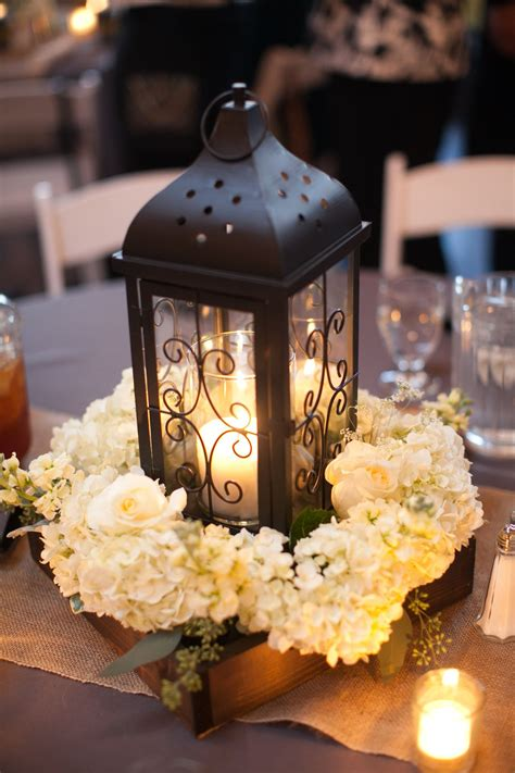 black lantern and white hydrangea centerpiece wedding