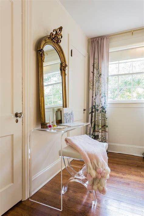 gold floating makeup vanity transitional bedroom