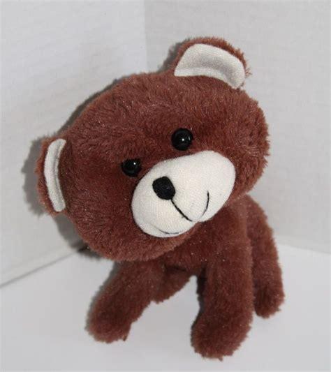 This Cute Little Brown Teddy Bear Has An Adorable Big Head