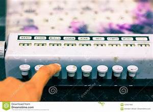 Technician Hands Pressing Buttons Of Side View Of