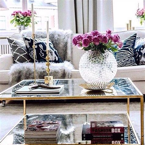 But the table is also an opportunity to create a vignette the key to any good coffee table is a variety, of both texture and height. 5 Key Pieces For A Chic Coffee Table   Chic coffee table, Decor, Black and white living room