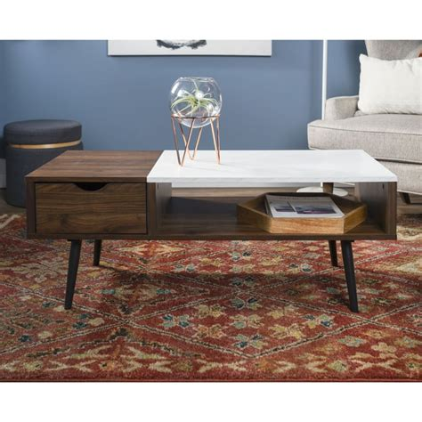 Gorgeous midcentury oval shaped coffee table with slightly slanted solid wood tapered legs, a walnut veneer top, and a breathtaking dark pecan finish. Manor Park Mid Century Modern Wood and Faux Marble Coffee Table | Best Space-Saving Midcentury ...