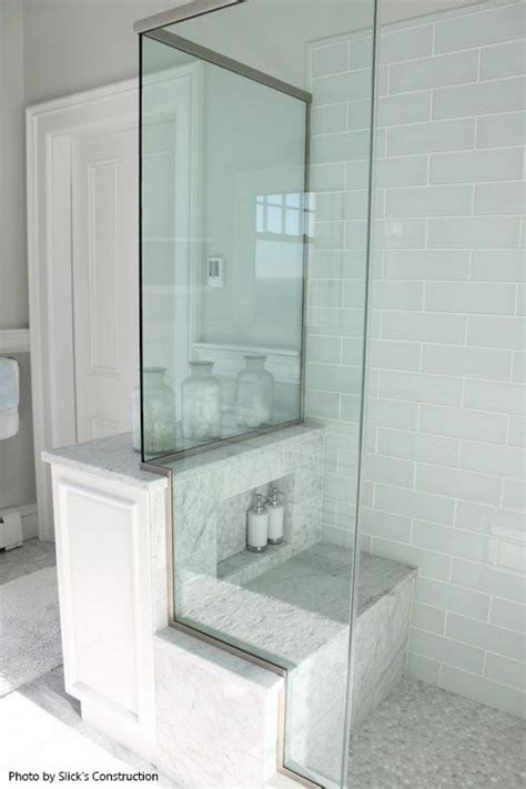 walk in shower with seat walk in shower with a back shower seat glass shower doors white subway tile all around and a