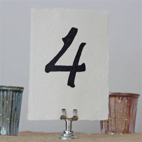 silver table number holders four small silver name card table number holders by the
