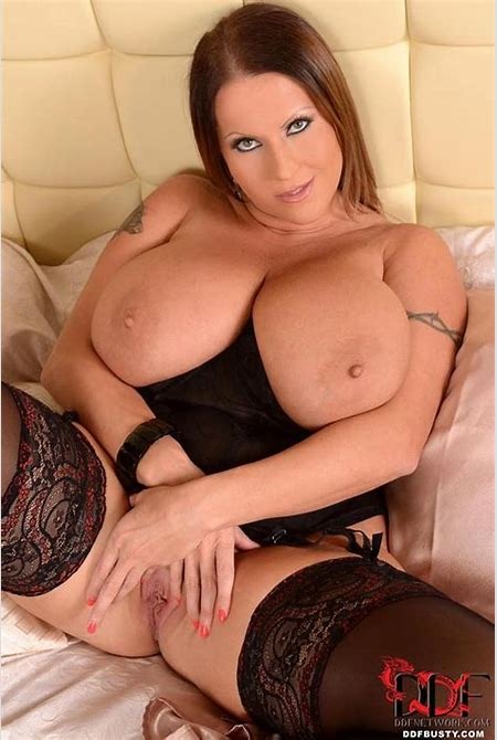 Impossibly busty milf babe Laura Orsolya strips out of sexy lingerie and toys herself on bed