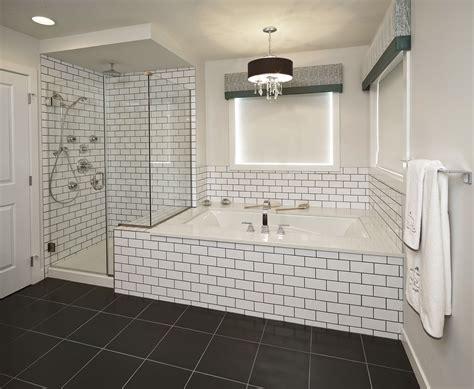 classic black drum shaded chandelier above white bathtub