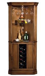 Howard Miller Bar Cabinet by Howard Miller Oak Cellars Corner Wine Cabinet Decanters Com