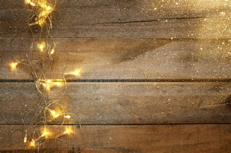 Christmas Warm Gold Garland Lights On Wooden Rustic