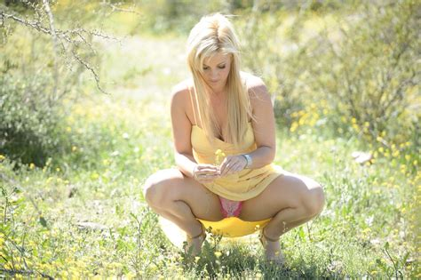 Lovely Blonde Model Gets Absolutely Naked Outdoors With No