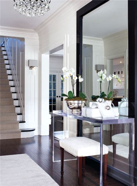 large floor mirror sofa table in a foyer gives the illusion of more space - Floor Mirror Behind Console Table