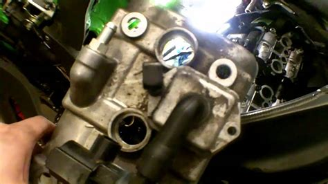 Valve Clearance Adjustment Using Shims On A Motorcycle