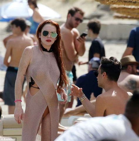 Lindsay Lohan Shows Off Figure In A Nude Dress And Sexy