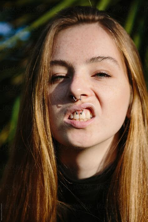 Pretty Young Woman With Freckles Showing Her Septum And