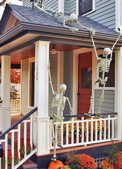 skeletons climbing house front porch halloween decorating ideas the garden glove
