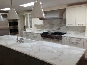 marble tile backsplash kitchen a remodeled kitchen with a slab of granite island matching backsplash thoughts for hummingbird