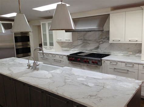 kitchen granite and backsplash ideas a remodeled kitchen with a slab of granite island matching