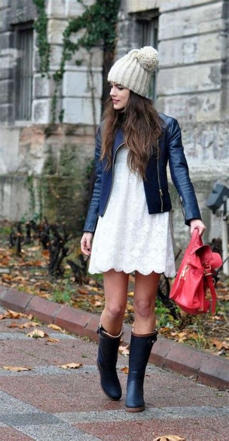 Picture Of a white lace dress a leather jacket and a chic beanie