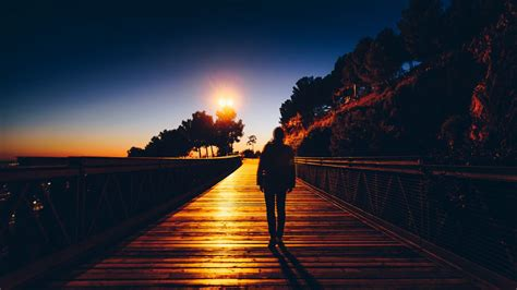 Download wallpaper 1366x768 silhouette, sunset, solitude ...