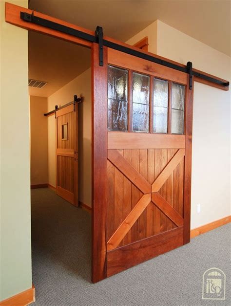 hanging a barn door from the ceiling?  Google Search