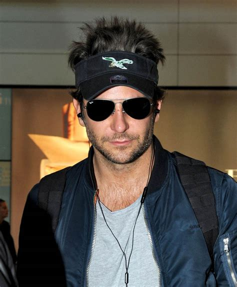 bradley cooper arrives  heathrow airport  london
