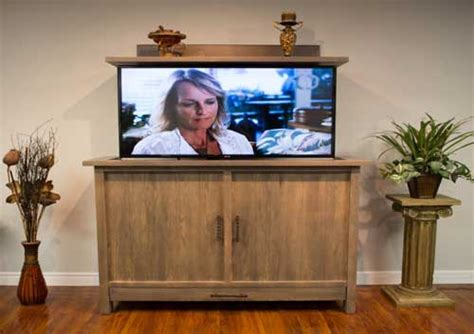 cabinet tronix rustic furniture has a built in tv lift kit to hide flat screen at tv lift cabinet canada brown square traditional