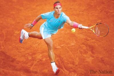 Nadal into 14th Roland Garros quarter-final