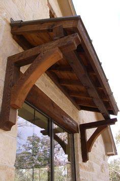 overhang stained wood  window  matching flower box  renovations   door