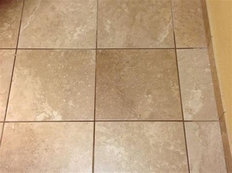 coffee spill settled in the tile grout of the entry foyer