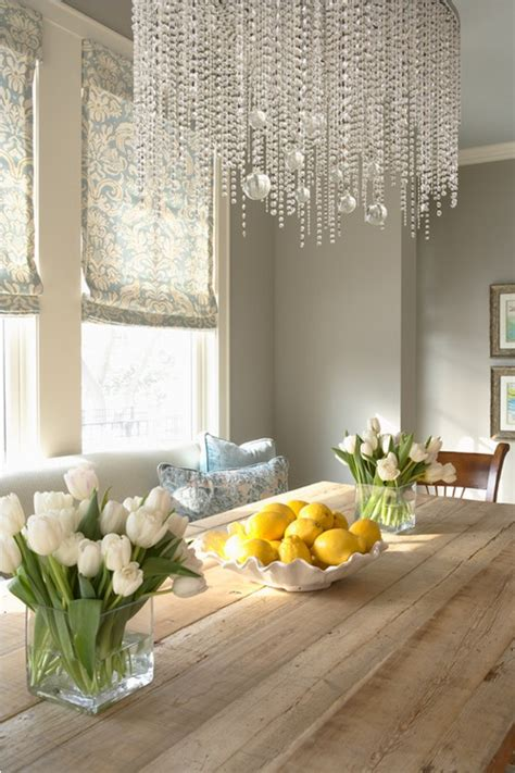 elegant living dining space  chandelier neutral wall