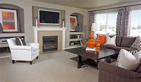 Living Room Colors That Pop by Orange Accessories Add A Dramatic Pop Of Color To This
