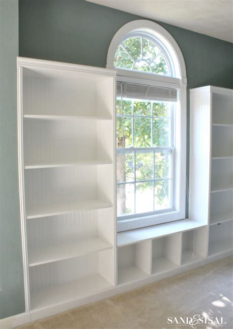 how to build a built in bookcase with doors diy built in bookshelves window seat sand and sisal